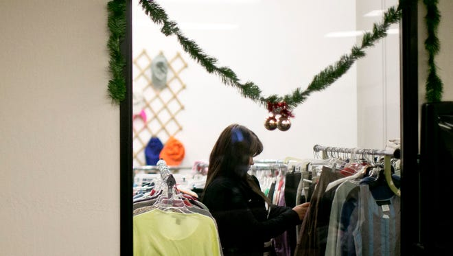 A shopper looks through clothes at the Jewish Family and Children's Services in Phoenix. The group aims to give young people coming out of the Child Protective Service program a leg up on their futures.