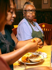 Murrie Glover, right, of Favor Home Cooking, sits with Latoya Lyons, left, in the restaurant at 117 E. Franklin St. near South Main Street in downtown Anderson.
