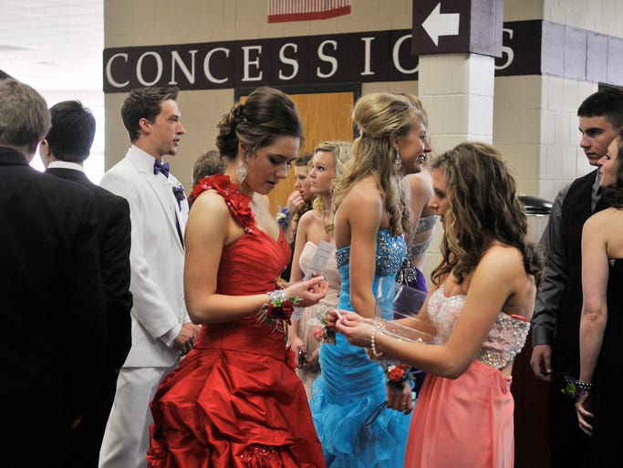 Students exchange corsages for prom at Albany High School Saturday in Albany.