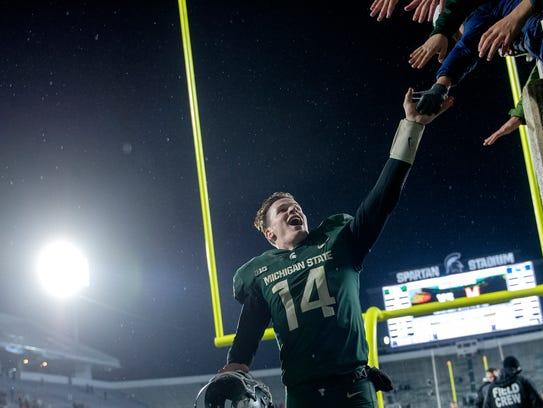 Michigan State quarterback Brian Lewerke celebrates