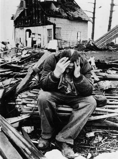 "Elam Smith, 66-year-old resident of Alto, Ind., is a picture of dejection as he sits among the rubble of what was once his home, on Easter Sunday morning, April 18, 1965. "" I'm too old to start over,"" Smith said. When several tornadoes swept through the region, almost the entire community was destroyed and there was no church left to attend Easter.  (AP Photo)"