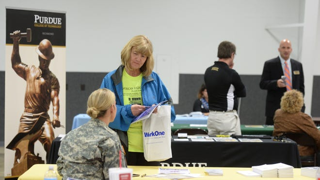 Participants gather information about jobs, health and education during a Veterans Resource Fair Thursday, Nov. 13, 2014, at the Kuhlman Center on the Wayne County Fairgrounds.