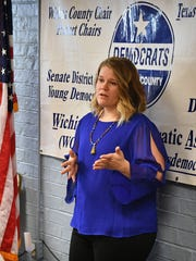 Catie Robinson addresses a group at the offices of