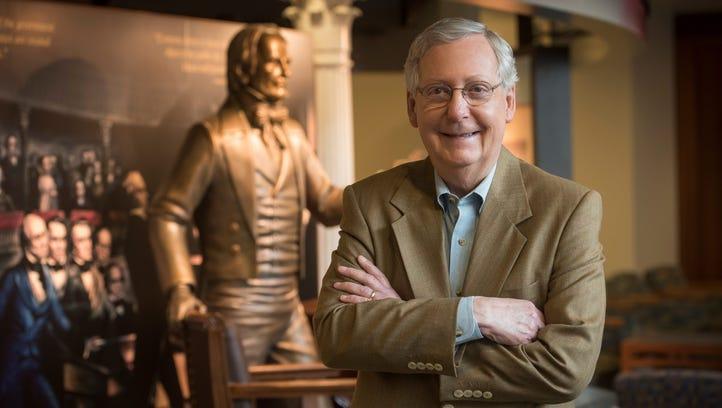 Senate Majority Leader Mitch McConnell near a statue