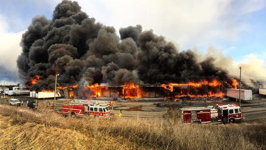 This photo provided by Nick Bowling shows a large fire