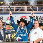 Sprint Cup Series driver Jimmie Johnson (48) celebrates winning the AAA Texas 500 at Texas Motor Speedway.