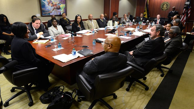 Gwendolyn Boyd, seated left, is interviewed before being offered the presidency of Alabama State University by the board of trustees Dec. 20, 2013.