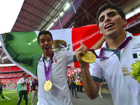 Mexico's players pose with their gold me