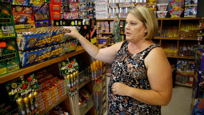 Laura Huish shows off a selection of aerial fireworks at ABC Unlimited at 5615 U.S. Highway 64. The aerial fireworks are prohibited within the city limits of Aztec, Bloomfield and Farmington.