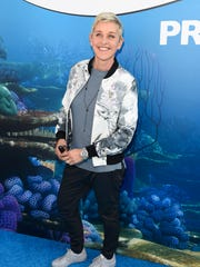 """In this June 8, 2015 file photo, Ellen DeGeneres arrives at the premiere of """"Finding Dory"""" in Los Angeles."""