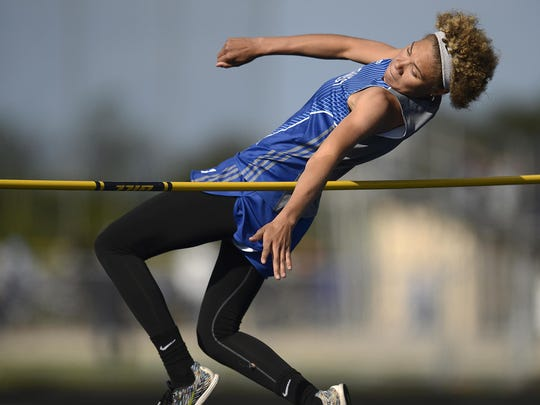 Green Bay Southwest's Natisha Hiedeman soars over the bar in the high jump during the FRCC track meet May 19.