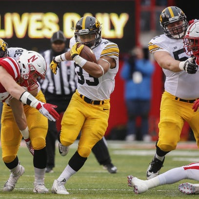 Iowa running back Jordan Canzeri runs the ball against