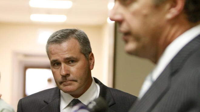 LDC defendant Daniel Lynch looks on as his attorney, Michael Schiano, speaks to reporters.
