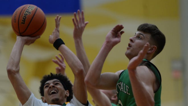 Northeastern's Tyler Smith shoots against Cloverdale on Saturday in Greenfield.