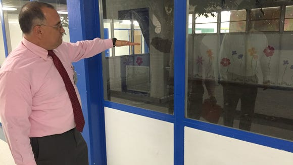An Ysleta Independent School District administrator explains how an Eastwood High School atrium floods when it rains.