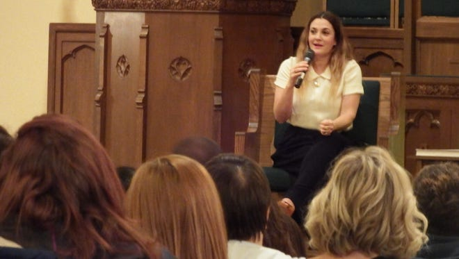 Drew Barrymore speaks to a crowd of over 700 people at a Prairie Lights book reading held at the First United Methodist Church on Thursday, Oct. 29, 2015.