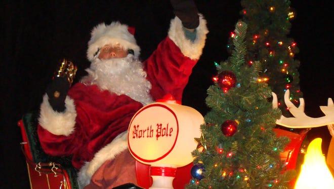 Santa rides the Neenah-Menasha Santa Float during his rounds in 2010.