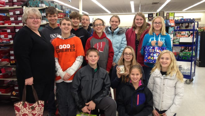 The Confirmation class at Trinity Lutheran Church of Arkdale recently purchased clothing and toys to fulfill seven Angel Tree tags. The seventh- and eighth-grade students requested funding from the Church Council and then met at a local Shopko to select gifts. The students also purchased nine items for Toys for Tots and items to put together seven kid's birthday bags for the Adams Area Food Pantry. The birthday bags include cake mix, frosting, birthday candles and a toy.