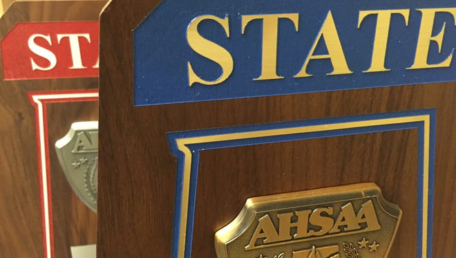 AHSAA championship and runner-up trophies.