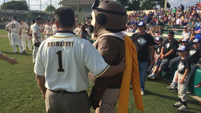 Baseball's back. Lafayette Mayor Tony Roswarski greets Lafayette Aviators mascot Ace before the team's home opener Wednesday at Loeb Stadium.