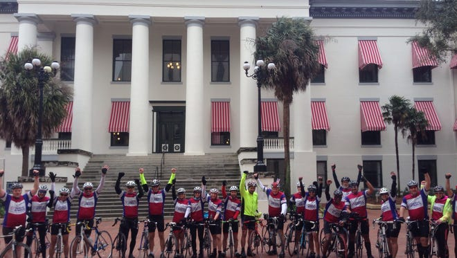 "Riders from a previous ""Capitol Ride"" -- a fund-raising event to help raise money in the fight to cure cancer -- gather in front of the capitol building in Tallahassee."