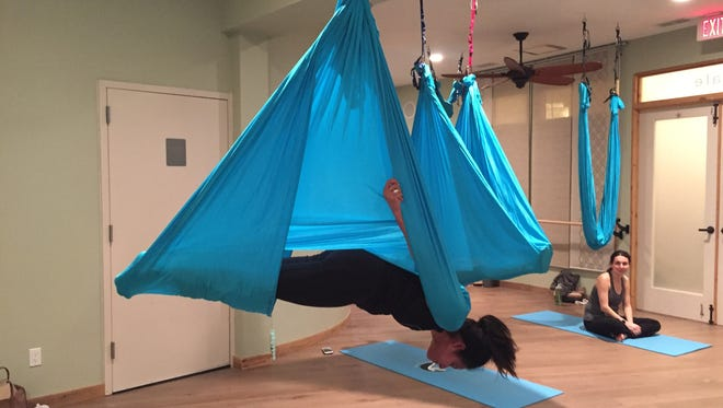 Reporter Karen Roberts does aerial yoga at Riverstone Yoga