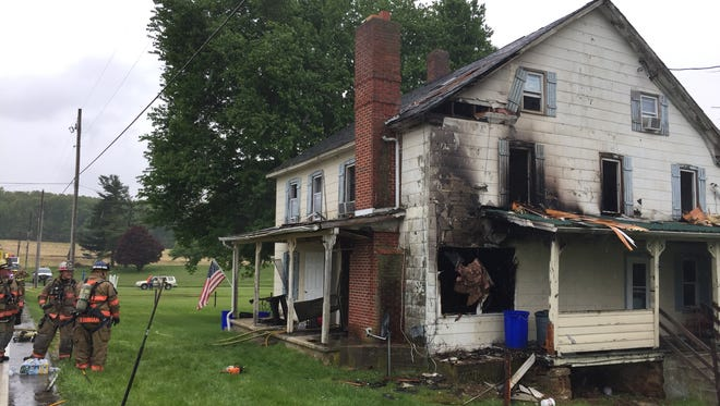 Firefighters responded to a house fire in Fawn Township Thursday afternoon. Two people were injured in the blaze, officials said.