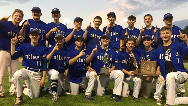Otter Valley poses with the Division II high school baseball championship trophy.