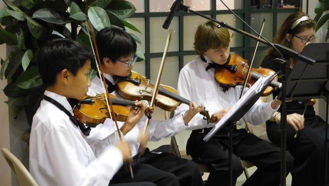 Deerlake orchestra students Alastair Deng, Jaden Choi, Dane O'Rourke, and Katelynn Large.