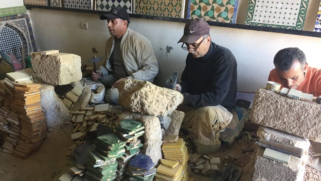 Abdelwahd Hafid, Mohamed Mohsime and Itri El Bermossi (left to right) in the workshop that El Bermossi manages. Hafid says the work is irregular, but he is proud that he can earn enough to support his family.