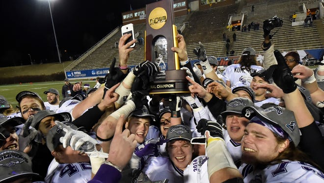 UW-Whitewater players celebrate after defeating Mount Union 43-34, winning the NCAA Division III championship.