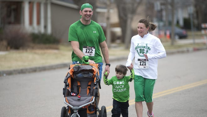 Participants run in the Sharin' O' the Green 5k Saint Patrick's Day race in downtown Fort Collins Saturday, March 15, 2014.