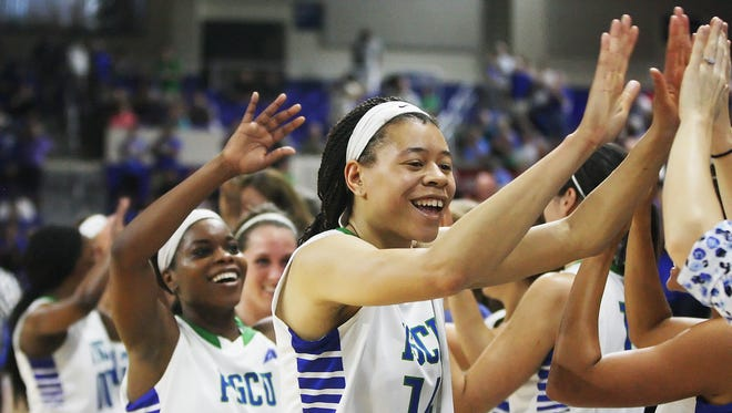 FGCU's Whitney Knight celebrates during the final seconds of the Atlantic Sun Championship game at Alico Arena in Fort Myers on Sunday. FGCU beat NKU 60-43.