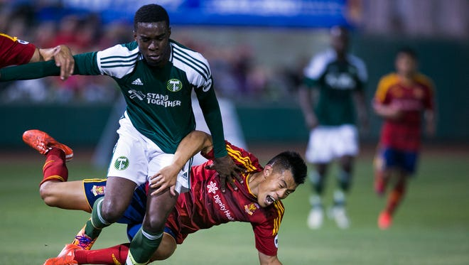 (From left to right) T2 defenseman Rennico Clarke and Arizona United forward Long Tan fight for the ball during the opening Arizona United home game against the Portland Timbers' team, T2, at Scottsdale Stadium, the new venue of AZ United April 25, 2015 in Scottsdale, Arizona.
