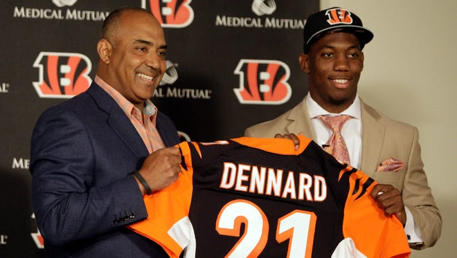 Bengals first round draft pick Darqueze Dennard from Michigan State and head coach Marvin Lewis hold up Dennard's jersey at his introductory press conference at Paul Brown Stadium last year.