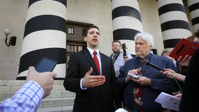 P.G. Sittenfeld spoke to the media on the steps of the Ohio Statehouse in Columbus.