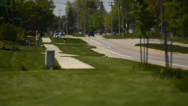 A sidewalk ends along Lawrence Drive in De Pere. The city will be completing an eight-year project to install sidewalks along the 2½-mile stretch of road from Scheuring Road to its southern border just south of Southwest Park.