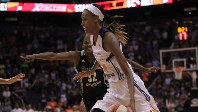 Mercury Forward DeWanna Bonner drives past Swin Cash at the game against the New York Liberty on Saturday, July 18, 2015. The Mercury were down by one at the first quarter.