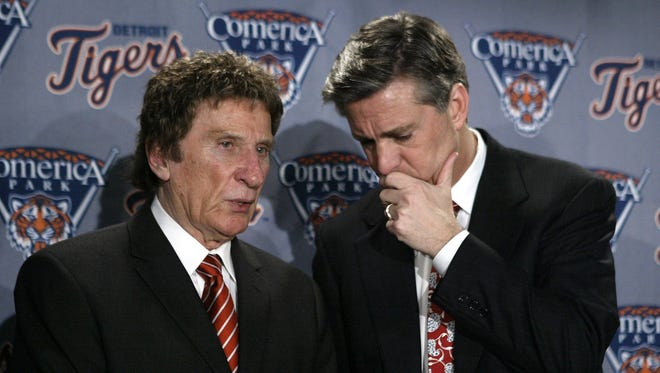 Detroit Tigers owner Mike Ilitch, left, talks with team president Dave Dombrowski  after a news conference announcing the signing of outfielder Magglio Ordonez to the media in Detroit, Monday, Feb. 7, 2005. Ordonez, the last remaining premier free agent of the offseason, and the Tigers agreed to a $75 million, five-year contract, a deal with two option years that could raise the total to $105 million over seven seasons.