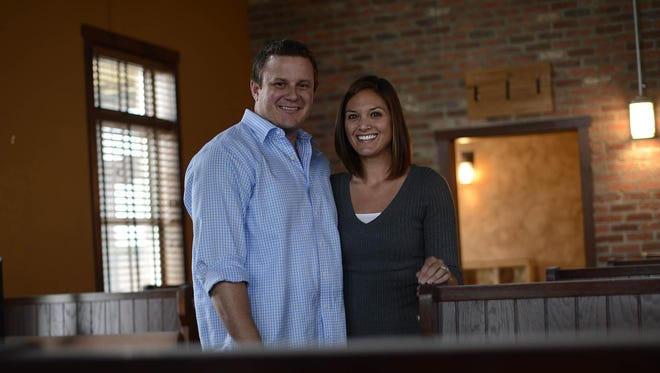 Co-owners Chad and Amanda Sharon stand inside Leatherhead Brewing Company in Green Bay on Monday.