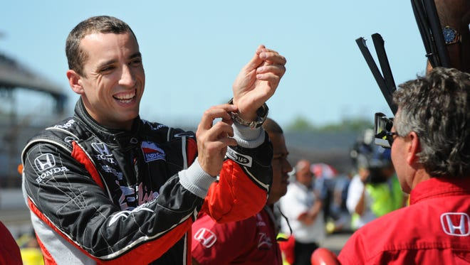 FILE -- Justin Wilson relaxes in the pits following a practice run at the Indianapolis Motor Speedway, May 14, 2009.