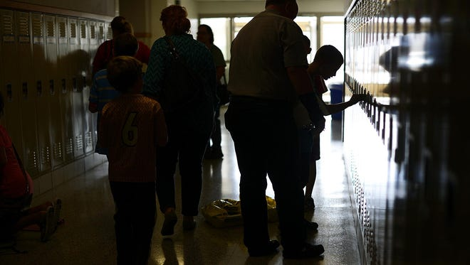 Students and parents fill the hallways during an open house and student orientation at Pulaski Community Middle School.