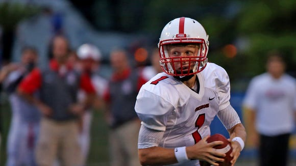 Center Grove quarterback #1 Joey Siderewicz runs out a play during the Center Grove at Carmel High School football game, Friday, September 4, 2015.  Center Grove won 24-21.
