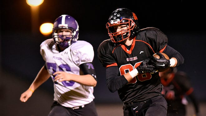 Rocori's Alex Anderson pulls in a pass and takes it past Little Falls' Hunter Swanson on a 50-yard touchdown run in the first half Tuesday in Cold Spring.
