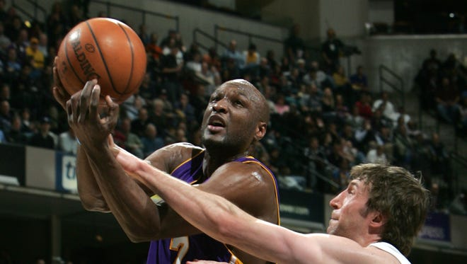 Former Los Angeles Lakers Lamar Odom (left) is fighting for his life.