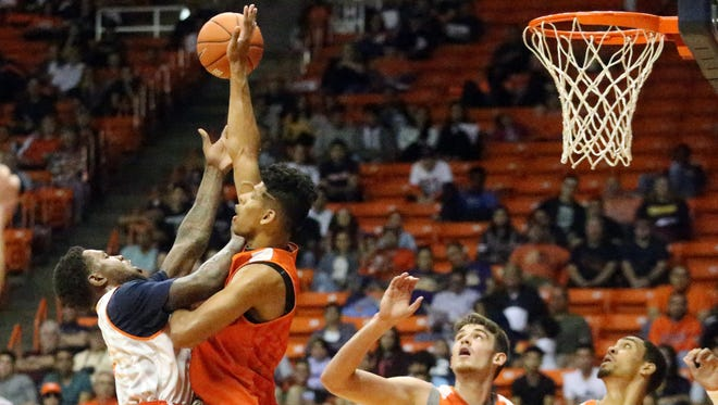 UTEP forward Terry Winn, left, goes up against Paul Thomas of the Orange team during the basketball team's Orange and White game Saturday in the Don Haskins Center.