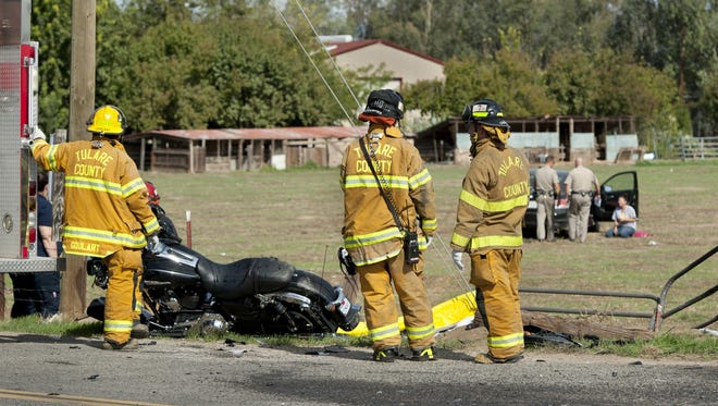 California Highway Patrol officers and Tulare County Sheriff deputies investigate a collision that killed a motorcyclist eastbound on Avenue 304 when his 2015 Harley-Davidson was struck by a Honda Accord northbound on Road 52 that failed to stop at the stop sign on Wednesday, October 28, 2015.