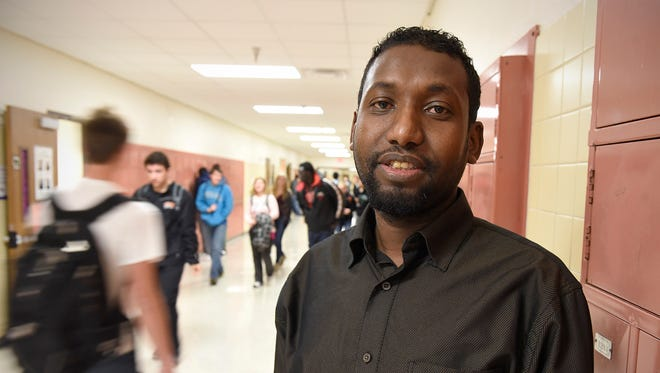 Ahmed Abdi, bilingual communications support specialist, can often be found in the halls talking to students between classes at Technical High School.