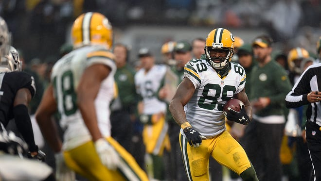 Green Bay Packers receiver James Jones (89) runs with the ball after making a catch against the Oakland Raiders in the fourth quarter at the O.co Coliseum.