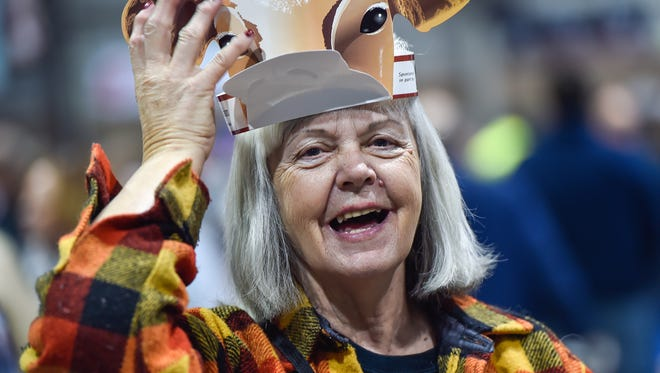Joan Robertson laughs as she puts on a cow crown on her head inside the 100th Pennsylvania Farm Show on Saturday, Jan. 9, 2016 in Harrisburg, Pa. Robertson is visiting from Taneytown, Maryland.